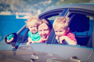 Mother in Car with Children - Auto Paradise Car Wash